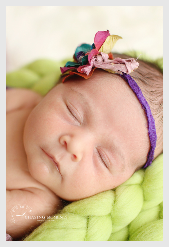 newborn baby girl asleep with headband