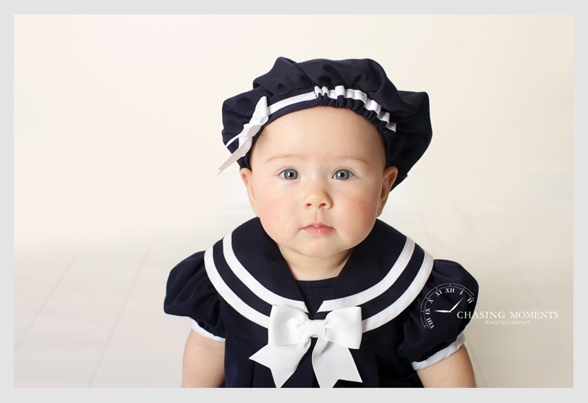 baby girl in navy outfit professional photographer
